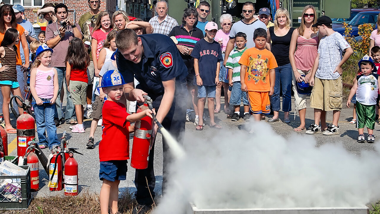 Educating the community: putting out a fire with an extinguisher