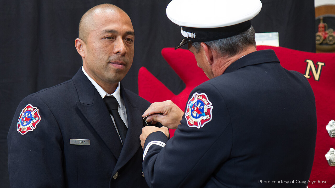 Pinning ceremony. Photo by Craig Alyn Rose