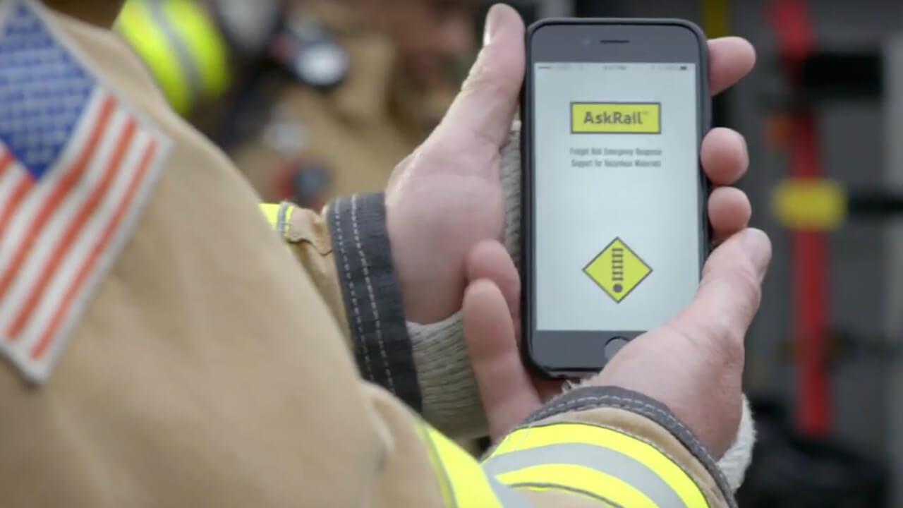 Firefighter views the AskRail app on mobile phone