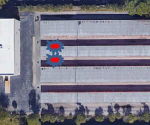 The UAS captured a picture of warehouses from directly above (smoke location added in red and blue icons).