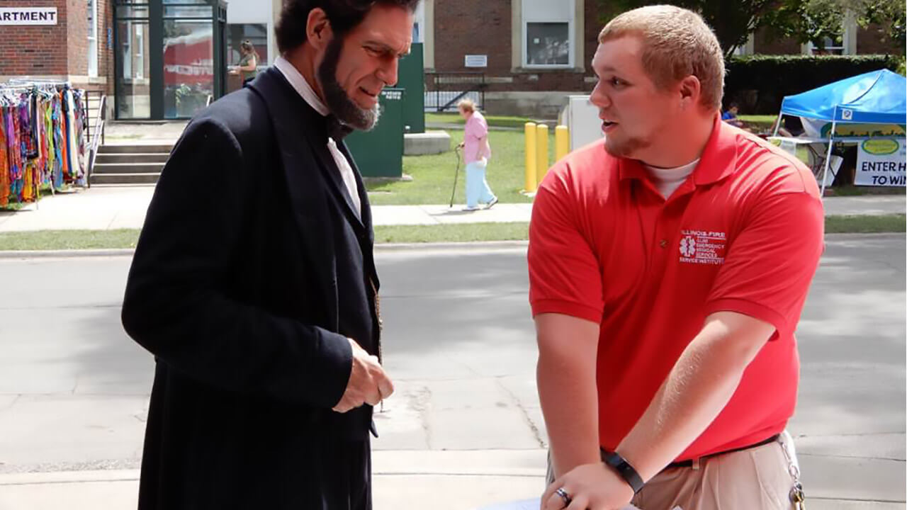 You're never too old to learn hands-only CPR… Illini Emergency Medical Services trained President Abraham Lincoln at the Illinois State Fair!