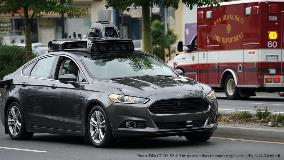 Automated vehicle prototype with San Francisco FD ambulance in background