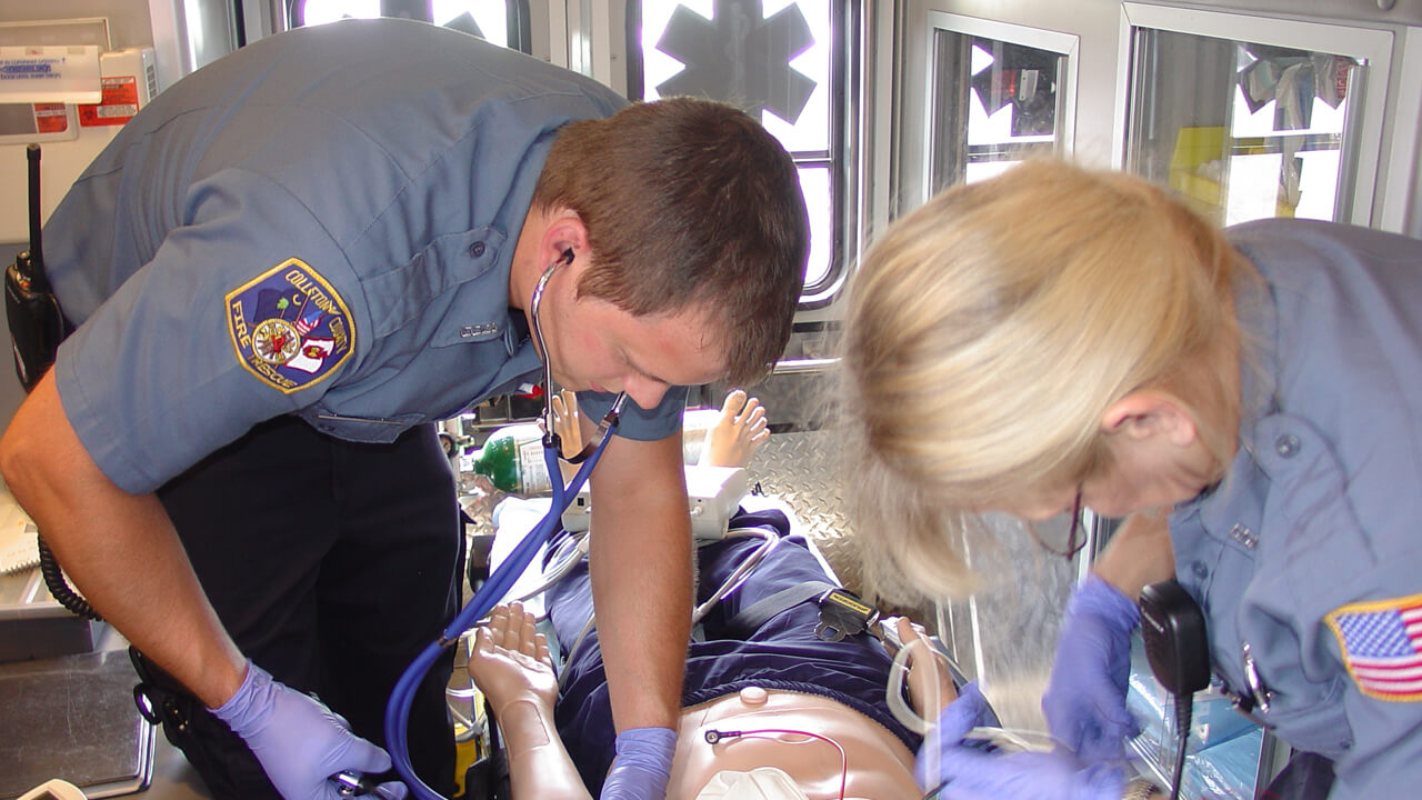 EMTs training in the back of an ambulance