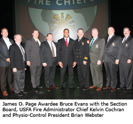 2010 James O. Page Awardee Bruce Evans with the Section Board, USFA Fire Administrator Chief Kelvin Cochran and Physio-Control President Brian Webster